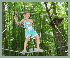 young boy climbing on ropes at Go Ape